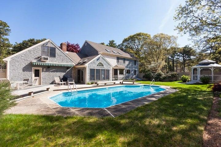 Private backyard with pool, gazebo and koi pond