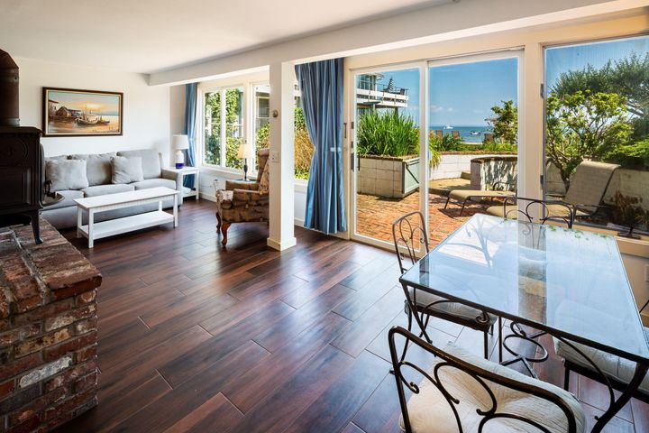 Dining area at one end of livingroom with view of the bay.