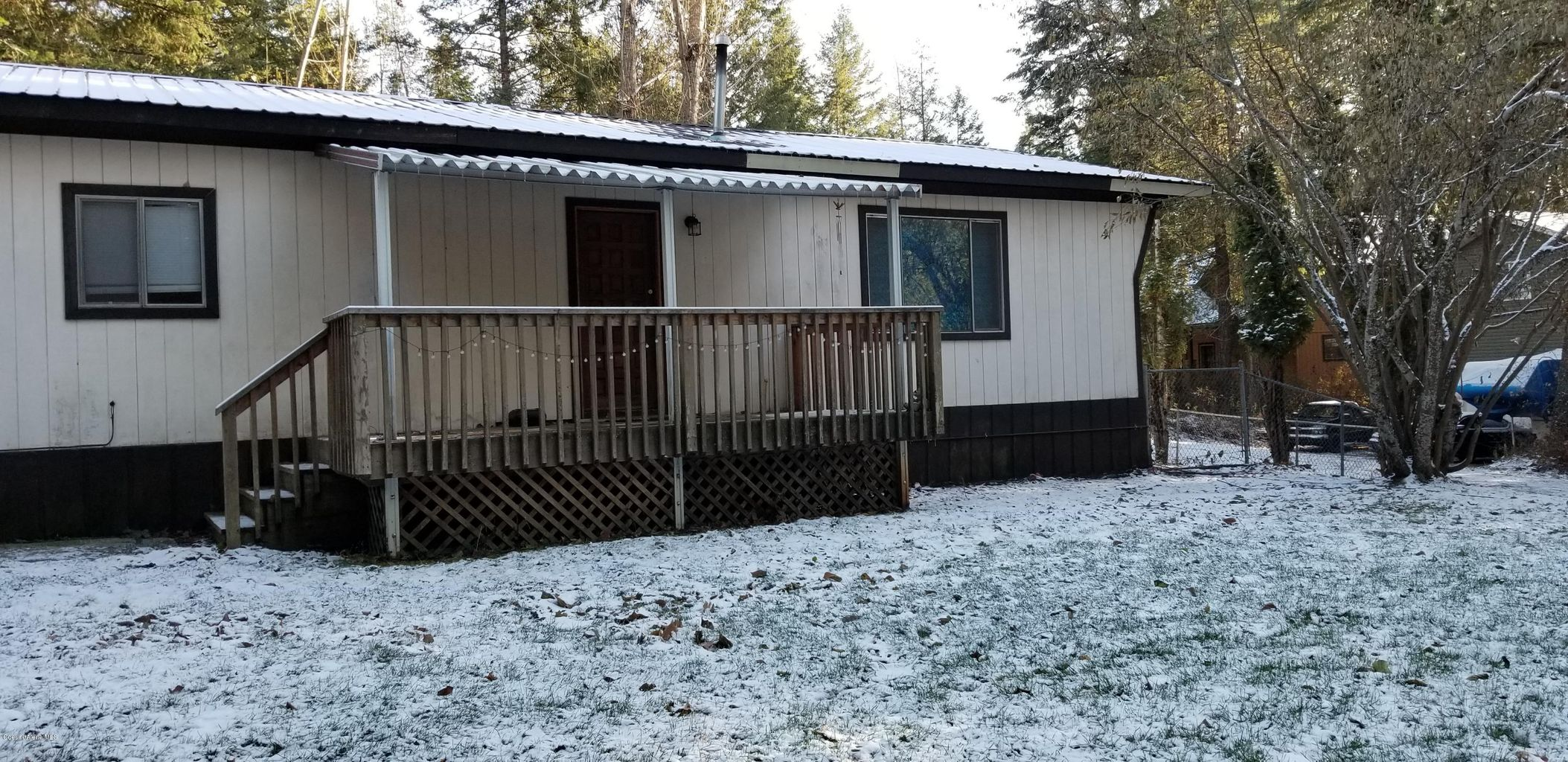 6586 W Twin Echo Road: Dbl Wide Manufactured home, 2 building lots, detached 2-car garage.