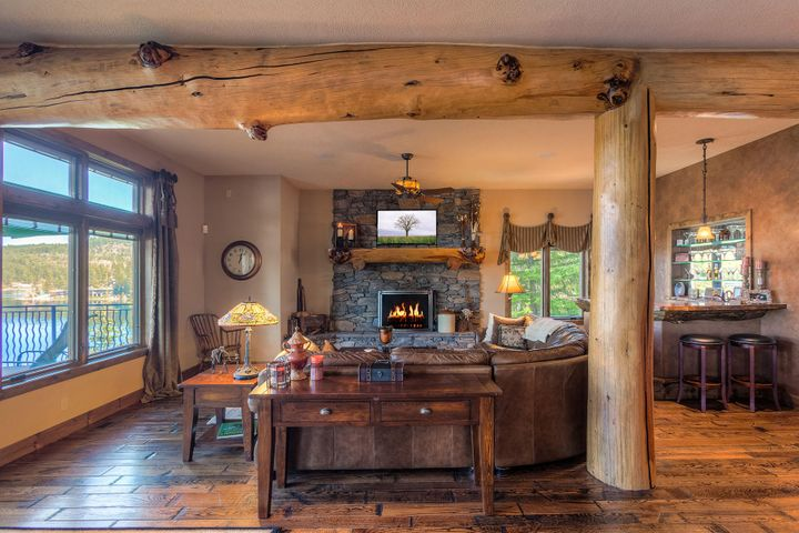 Rustic elegance with log beams, stone fireplace, rough hand hewn wood floors and incredible attention to all the little details