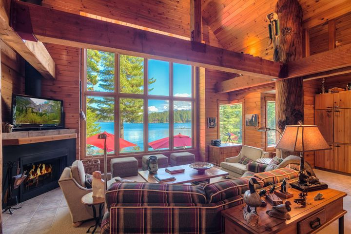 Let in the lake and sun with this sophisticated open plan, beamed design around the lake life. Gas and wood burning fireplace, pine tongue and groove walls and ceilings and a warm and inviting house for multi-generational memory making living.
