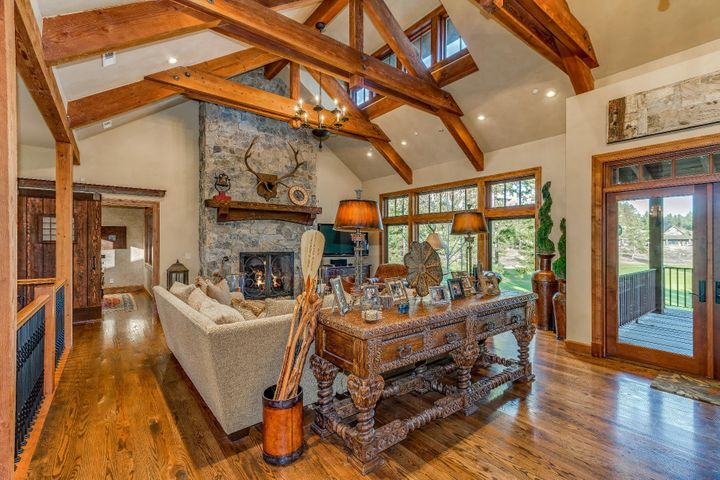 Wood beamed vaulted ceiling with automated windows, stone gas fireplace and abundant light welcomes you. Walk out to your deck and enjoy the golf course views and private location.