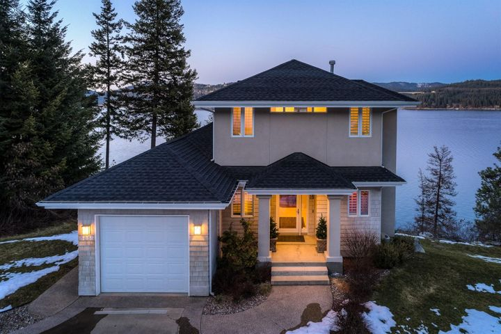 Views, 100' Lakefront, 3 car garage (1 attached, 2 detached) 3 bed, 2.5 bath, 2404sqft of perfection on .67 acres overlooking Coeur d'Alene Lake