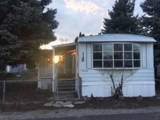 This is in a Great Location within the Park, no neighbors across the street. Cute fenced yard with a covered deck. Nice little storage shed stays with the property. New carpet throughout along with a new Gas Forced Air Furnace, and a New Tankless Hot Water Heater.