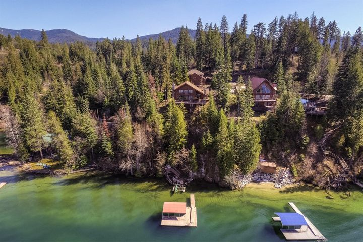 Lake living at it's finest on the East side of Hayden Lake, with 4 Bedrooms (3 are master suites) and deep water with your own private dock!
