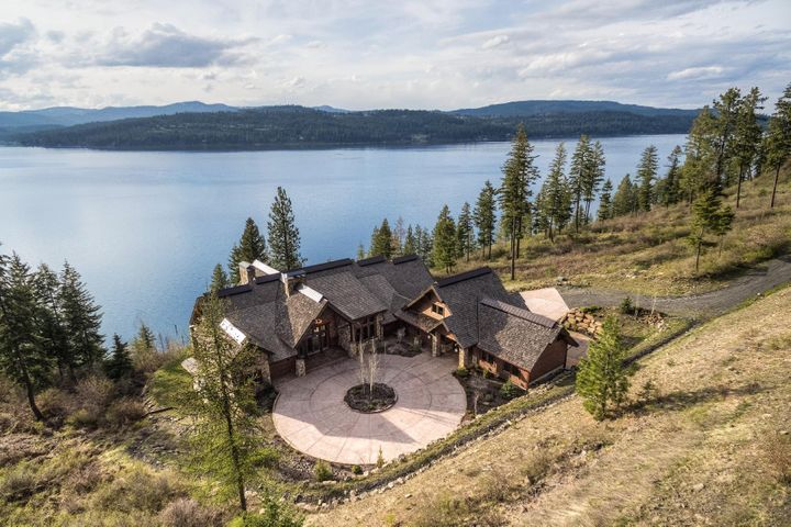Incredible Coeur d Alene WATERFRONT home with over 8500 SF, Dock and Tram, luxury finishes, privacy, acreage and serenity.