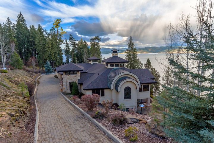 Stone paved driveway leads you to this spectacular setting on the lake. Private, end of a cul-de-sac, behind two gated neighborhoods, perched above for privacy and views, timeless, extraordinary, breathtaking.