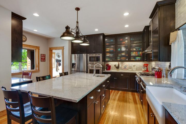 Luxury remodel of entire kitchen in 2018 with hickory cabinets, farm sink, roller cabinets and doors, planning desk and more.