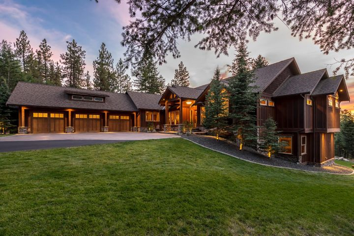 6,844 sf Rustic Elegant Craftsman home on 10 acres only 10 minutes from downtown Coeur d'Alene in the desirable enclave of high end homes. Gated Sundown Ridge Estates.