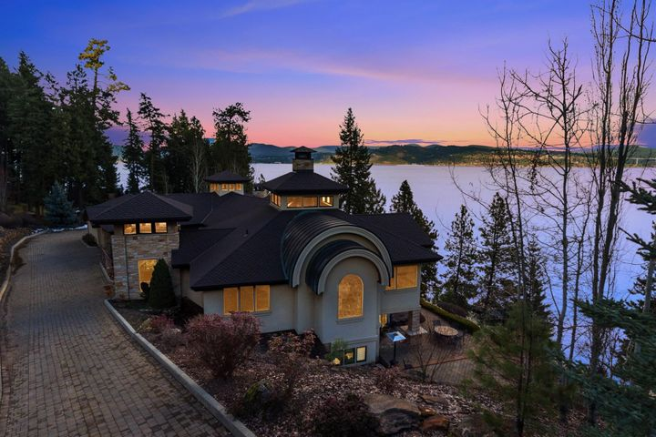 Can't get much better than this...truly spectacular 7800 SF home on 1.4 acres on the Shores of Lake Coeur d Alene...double private waterfront lot-291 Waterfront Feet. Sandy beach. Timeless Simple elegance.