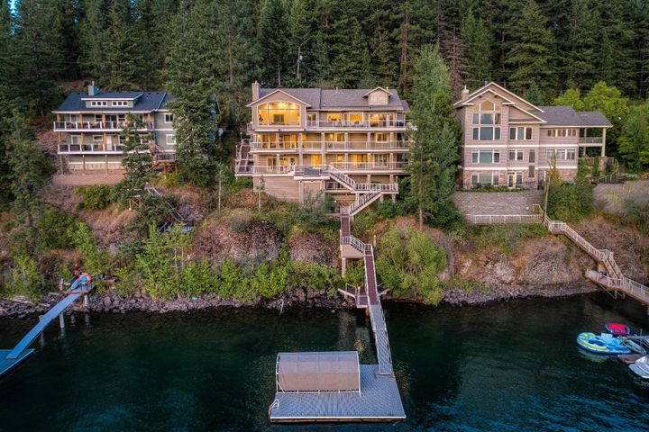 6 bedrooms, 3.5 bathrooms, 6,332 sf on .22 acres with 100'ft deep water frontage