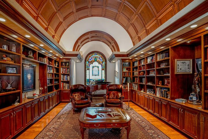 The signature black walnut barrel ceiling library is a one of a kind design. Just off the great room with stained glass accents from 1887, beautiful hardwood floors & under cabinet mood lighting...this will quickly become one of your favorite rooms