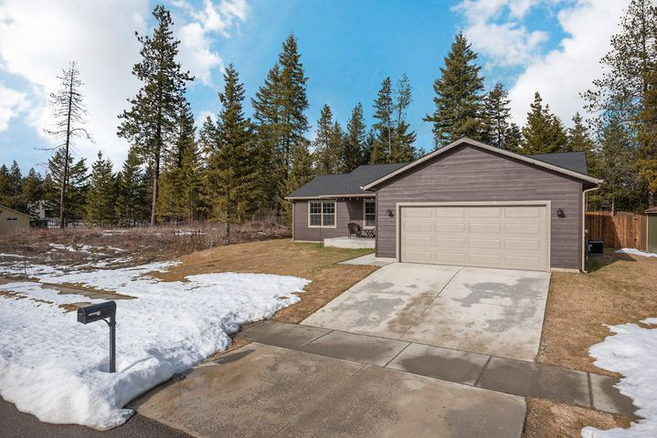Better than new and gorgeous Spirit Lake single level home with 3 beds, 2 baths, AC, Fenced yard and PRE-INSPECTED
