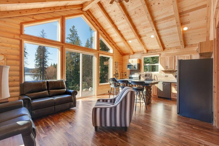 Spectacular open plan living with big picture window! Can live in this one and rent out the big ranch house or send the family over there!