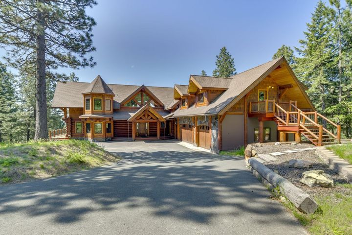 Log and Stone beauty-Details of Log and Stone define this one of a kind Log Home nestled in the foothills of North Central Idaho. Perfectly placed in the setting. 9000 SqFt, 3 separate living spaces.