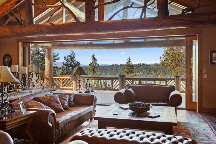 Trusses from Montana, stone from Idaho, large sliders to extend your living to the huge wrap around deck overlooking Lake Coeur d Alene.