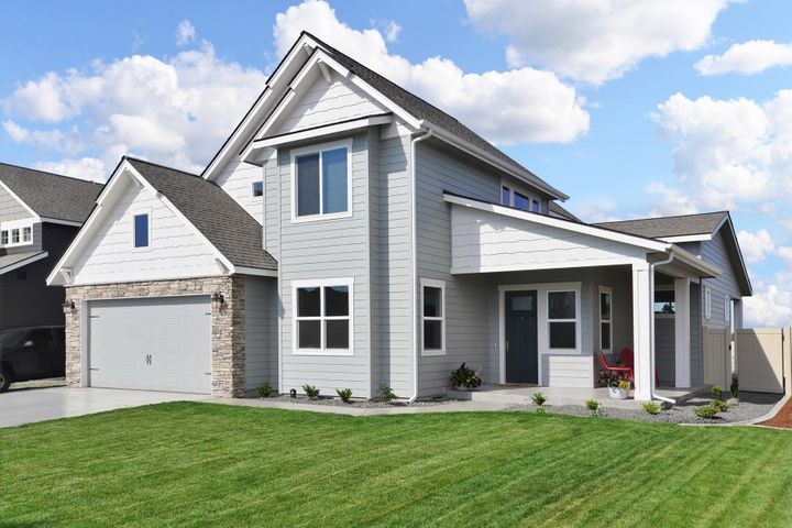 The Palouse is a two story home with a vaulted entry, which includes three bedrooms and 2.5 bathrooms with an additional office/guest room.