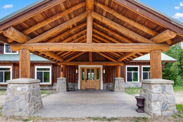 15000 SF with 10 Bedrooms, Commercial Kitchen, a separate 4 bedroom guest home on 37 acres...Conditional Use Permit for RV Park as well. Log and Timber sets the mood for this lodge/home. Welcoming!
