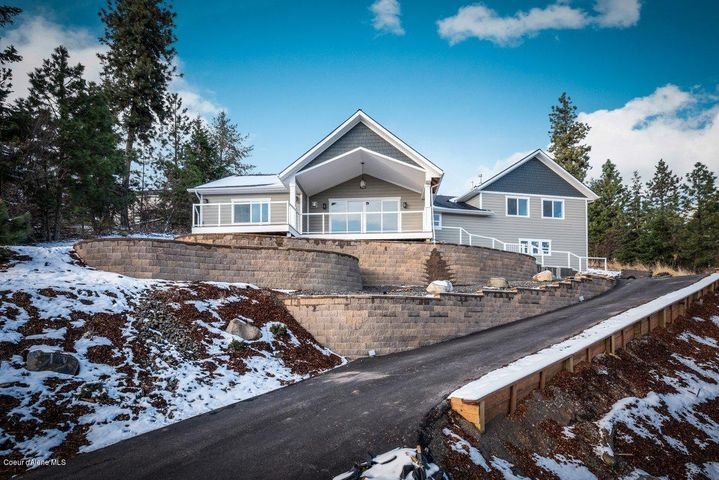 Just completed! Elegant and serene home with world class views of Coeur d'alene