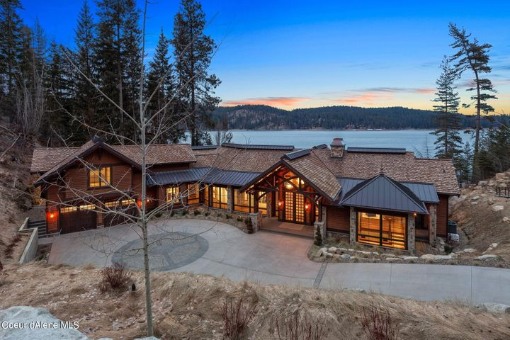 Spectacular Hedlund Designs work of art boasting Lakefront setting and over 10,000 SF of Luxury Living - 4 bedroom suites with Theater, office, master suite on the main and incredible Saloon Rec room and Whiskey cellar.