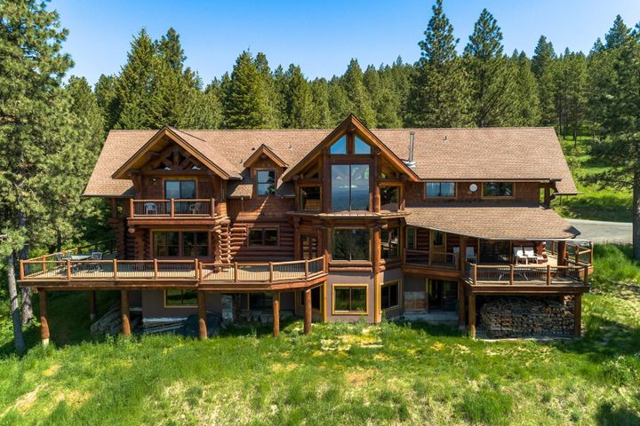 Low maintenance and Natural landscaping accent the beauty of this Idaho Log Castle