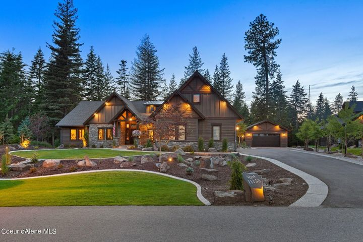 Captivating Luxury Craftsman at The Falls at Hayden Lake with a Boat Slip! 3 bedrooms - All with Ensuites Plus Office and Bonus room; 3.5 baths; 3254 SF; .77 acre backing up to forested land.