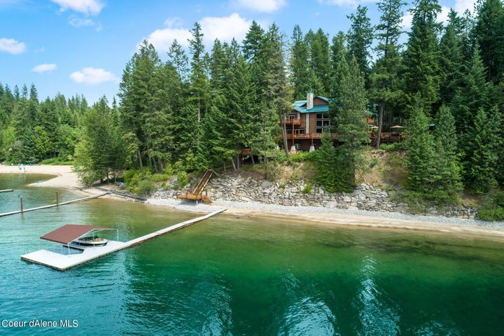 One of the most spectacular homes and settings on Hayden Lake. In Sunset Beach with 100' of sandy beach and western sunset views - Stunning 6 bedroom, 8900 SF home !