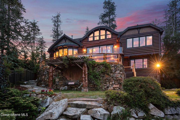 Upon the Basalt Cliffs of Hayden Lake, The Distinguished Home of 10646 N Lakeside Drive, Welcomes You Home!