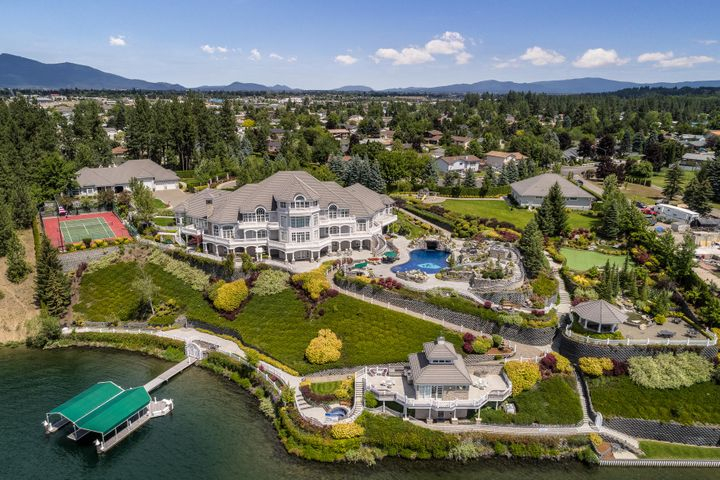 PACIFIC NORTHWEST RETREAT - Truly is perfect for large family retreat, corporate retreat, use your imagination.  Imagine 26,00 sq.ft. of ''5 Star Hotel'' quality, large home theater, exercise center, outdoor salt water pool, putting green, tennis and much, much more.  Very private 3.8 acre site with 452 feet of deep water frontage.  10+ car garage, caretaker home and large shop.  Irreplaceable.