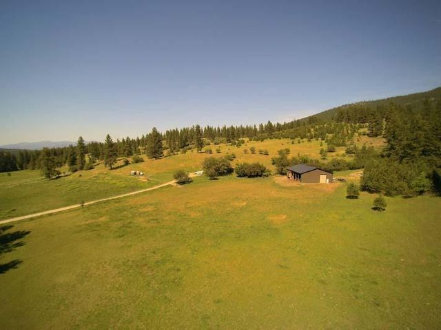 This beautiful and secluded 10.5 acre property is nestled in a valley just 7 minutes from the I-90 freeway between Spokane, WA and Couer d'Alene, ID. 5 minutes to Liberty Lake, WA and 10 minutes to the Spokane River. This charming older home has not only potential but some history as well. Upgrades have been made to the kitchen, living room, upper floor and upstairs bedrooms. There is potential to split the acreage and sell, or build a second home and use one for rental income. The 50' x 72' pole building is currently being used as a barn with a 24' x 25' enclosed shop or it could be converted to a 4 bay large shop with room to park an RV and much more.