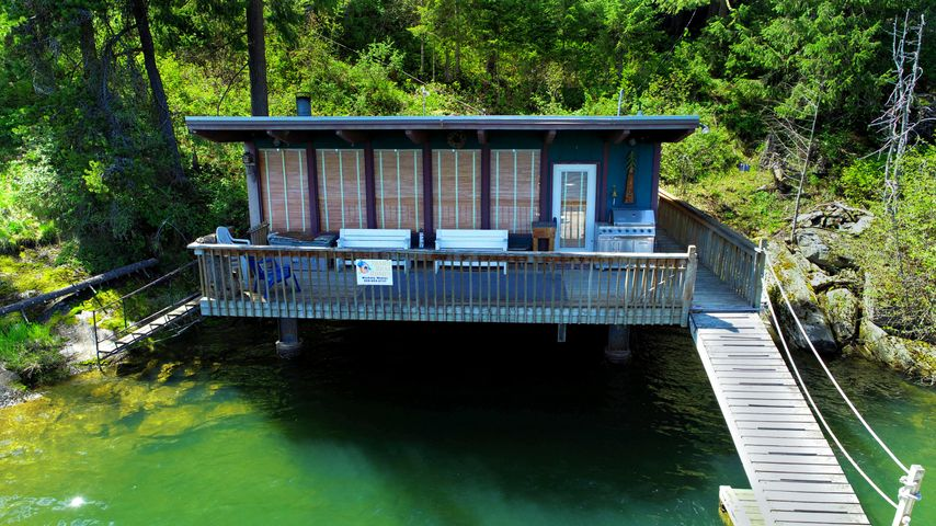 Tucked into a quiet Peninsula in Mica Bay this one of a kind cabin is ready for a new adventure.   Built over the water with a unique steel structure.  This home is a tank for strength.   Home has 2 beds, 1 bath and sells furnished.  Roof is a concrete roof used for sleeping under the stars for additional space.   Less than 15 minutes to CDA by land the location of this property couldn't be better.