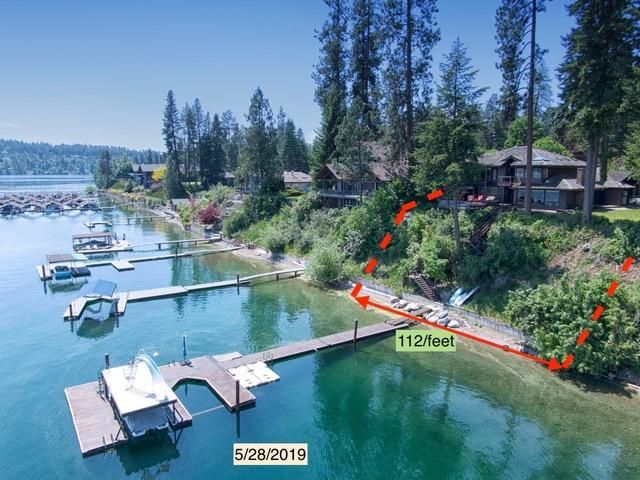 Gold Coast'' Hayden Lake Waterfront - Rare chance to live on the water proximate to the iconic Hayden Lake Country Club (a two-minute walk to the Clubhouse and first tee box) and one of the finest locations on Hayden Lake.The home is set on a bluff above the water's edge with a 55-foot staircase to 112-feet of shoreline, all with a majestic 180 view of one of Idaho's prettiest lakes.This rural setting is a close-to town location and a short two-mile drive to grocery and hardware stores, banks, gas stations, restaurants and more.