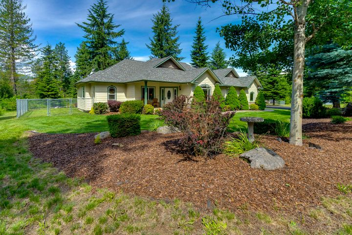 Set among the pines in beautiful Elkhorn Ranch Estates is this stunning 2200+ sq ft home featuring a fully insulated 36x50 shop with gas heater! This home sits on 4+ acres with 3 bedrooms plus an office and 2.5 bathrooms. Desirable split bedroom floor plan, spacious kitchen with custom wood cabinets, granite countertops, breakfast bar and a large pantry. Living room with rock surround fireplace and a luxurious master suite with tiled walk-in shower, separate soaker tub, dual sinks and a huge walk-in closet! Step out the french doors off the dining area to the covered patio overlooking the fenced backyard with gorgeous mountain views! Enjoy the peaceful and quiet park-like setting close to town!