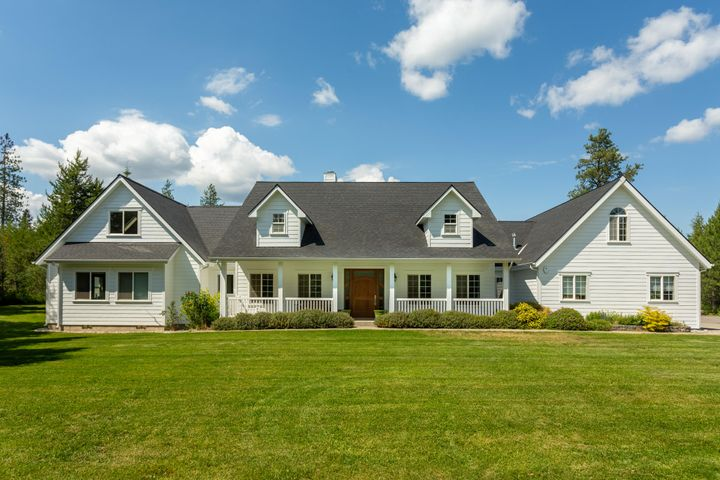 Beautiful Cape Cod style home with shop on 5.38 acres in the desirable Bar Circle S Ranch neighborhood of Rathdrum, Idaho. Great curb appeal with a covered front porch and dormer windows. The home has 5 bedrooms, all on the main floor; including 2 master suites! 4377SF on the main floor with 1616SF on the upper level featuring THREE bonus rooms and a bathroom. Enjoy the outdoors from the large back patio, or from the beautiful lawn and landscape. A lush rural setting, yet you're just 10 minutes to Hayden! The shop is 30' x 90' with a loft, bathroom, and lean-to. You'll also notice a new roof, siding, paint, 2 furnaces, a tankless hot water system, and new landscape including sprinkler system. Owner is licensed real estate agent in the state of Idaho.