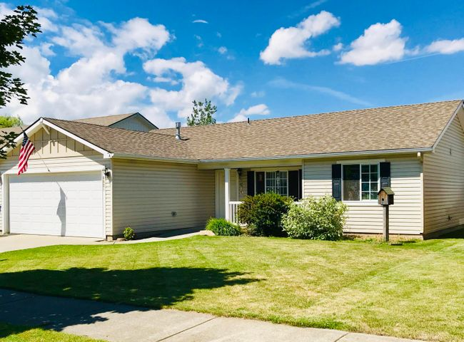 Great single level home in desirable CDA Place. No rear neighbors! 3 bedroom, 2 Bath. Split floorpan. NEW carpet and Paint throughout. Newly fenced yard. One house away from the community park on a quiet street.  WASHER, DRYER, AND FRIDGE INCLUDED!!