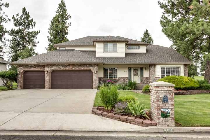Your wonderful opportunity has come to move into this beautiful 5 bed / 3.5 bath home in the Highland Golf Community of Post Falls, ID.  This extremely well maintained and upgraded tri-levelled manicured custom home, with 91/2 foot ceilings, wainscoated foyer and formal dining room, built in library shelving, beautifully maintained hardwood flooring, includes well-appointed kitchen appliances, pantry and kitchen island.  Well insulated with double paned windows and doors, this home remains very ''comfy'' with its recently installed heating and commercial air conditioning system. The home has tremendous closet space and storage throughout, including a fully insulated 3 car garage and handy garden shed. Beautiful curb appeal and extensive, fully covered seamless rain gutters,