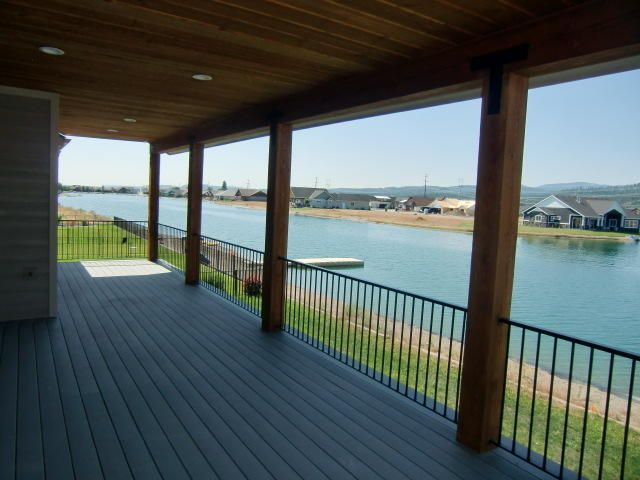 Completed custom waterfront Home in Radiant Lake Estates which is a gated community. Home features include 2 gas fireplaces, huge walk in tiled mud set shower with multiple heads, huge tub in master, incredible covered deck looking at the lake and mountains, quartz countertops thru out with under mount sink, heated garage, lower level garage to store toys for the lake, central a/c, 16 foot double slider in great room, knotty alder cabinets with 42'' uppers and 3 1/2'' crown molding, 9 foot ceilings and vaulted, 95% gas forced air furnace, full yard landscaping and sprinkler system.