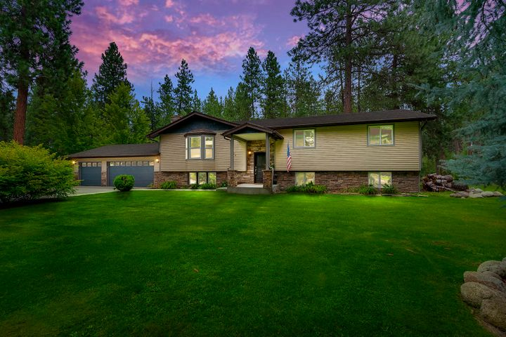 Beautifully remodeled Post Falls home with WATERFRONT ACCESS! This 5BD/3.5BA home boasts 3,120 sq.ft. on over half an acre with room for a shop. In the open kitchen you'll find custom cabinets, stainless appliances, breakfast bar, double wall ovens & pantry.  The spacious master suite includes a dual sink vanity, beautiful step-in tile shower & walk-in closet. Features engineered hardwood floors, 2 wood burning fireplaces, A/C, updated plumbing & electrical, new cedar siding and a new roof. Don't miss this great opportunity to enjoy living on the north side of the river, on county land with waterfront access and community docks!