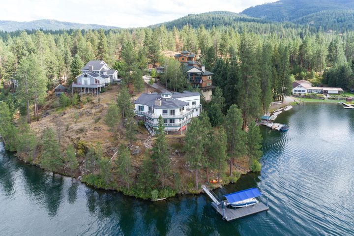Don't worry about snow! ''HEATED DRIVEWAY!''  This spectacular 3,614 sf waterfront home with new private 30 ft. dock, overlooks Crystal Cove Bay and Spokane River with a 260 degree view from its 1200+ sf deck on both stories. In 2018, the home was newly painted and caulked, and seamless rain gutters were installed throughout.  New high-end Lennox HVAC system and Lennox mini-split were installed in 2018 along with a 16kw whole house Generac generator, and a high-end whole house AquaSonic water purification system. A new 1,000 gal. buried propane tank upgraded fuel capacity for heating and cooking. The well and 3,000 gal. cistern have both been upgraded with new pumps, electronics and metal casing in 2018.  The septic system pump was replaced in 2019. The security system includes