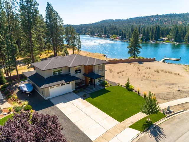 Introducing a Spokane River PREMIER view property. You will never tire of the amazing river views in this light and bright modern prairie style custom home designed by a local architect and owner/interior designer. The home has been designed to emphasize the expansive, unobstructed Spokane River view. The river view is protected by a 50-foot set-back requirement of the adjacent lot to the south and the Ross Point Recreation water front park to the east. The 3,159 sq. ft., 3 bed/2.5 bath home has everything you can dream of: 9' ceilings on both floors, gourmet kitchen with custom cabinets, huge Cambria quartz island, composite sink, large pantry, stainless steel appliances (full List of Amenities in Documents).