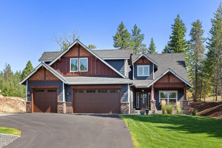 Stunning 1.03 acres custom award winning Selkirk Builder ''Wild Ridge Estates'' home featuring; 3 bedrooms plus Bonus Room/Second Master, plus den/office. Private lot on private road! Custom Alder Wood Wrapped Windows and Trim throughout. Bonus room has full bathroom as well as walk in closet. Massive covered patio piped for gas heater, bbq, with aggregate pad wired for hot tub. Matching 12' x 16' custom built shed. Wired for shop and beautiful landscaping! Hunting access to Inland Paper/Rathdrum Mountain. Owner/Agent