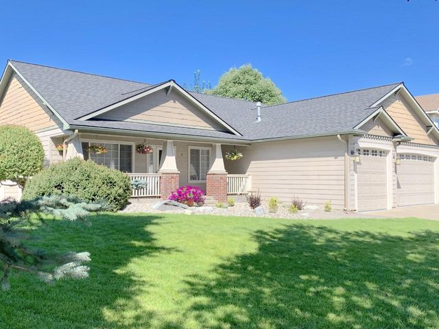 Beautiful and Spacious 4 Bedroom 3 Bath Home located on a Corner Lot in Coeur d' Alene Place! Newer wood laminate floors, roof, hot water tank, furnace, A/C, interior paint, lighting and radon mitigation system...and the list goes on! Main floor living, large open kitchen with granite counter tops, deck, office and a 3 car garage. This property is pre inspected and will come with a one year home Warranty!