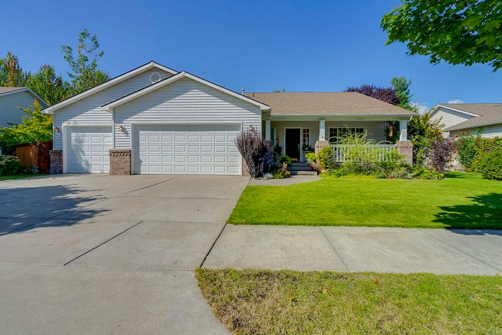 Immaculate, turn key home in Coeur d'Alene Place close to park on quiet street. 4 bedrooms, 3 baths with vaulted ceilings, large rooms, gas fireplace in living room, 3 car garage. Gorgeous gardens and hot tub included! Fully sprinklered and fenced. Covered front porch to sit and relax after a long day.