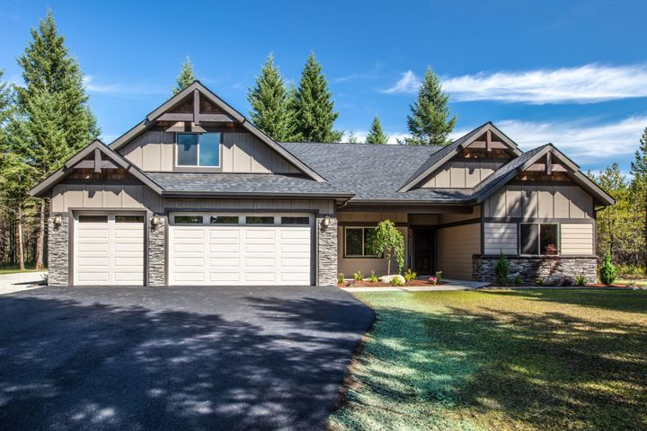2019 Parade of Homes Masterpiece! This stunning 3 bedroom 2.5 bathroom home sits on 5 treed acres in Wilderness Ranch and boasts 2328 sq ft of luxury. Step inside this custom home featuring a spacious living room with tongue & groove ceilings, beam accents and a grand floor-to-ceiling fireplace w/ built-in shelves. The gourmet kitchen offers a breakfast bar, rustic alder cabinets, granite countertops & thermador appliances! Escape to the private master suite with vaulted ceilings and a private bathroom featuring a walk-in tile shower with flat pebble floor and dual sinks with granite countertops. This exceptional home includes exterior masonry accents, front yard landscaping, a sprinkler system and attached 3 car garage! Don't miss your opportunity to own this home!