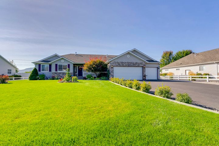 INCREDIBLE VALUE!!! Don't miss this Charming well maintained Rancher with a Shop set on a beautifully landscaped 1/2 acre lot.  This home offers 2 Master Suites (1 main-floor), Well laid out kitchen with storage and granite counters. There is a pellet stove in the upstairs family room and a gas fireplace accenting the formal living room.  A Large family/game room downstairs with a wet bar.  Outside there is a wonderful covered patio, private backyard with  A large  30 x 36 shop with 12' lean too, 3 car garage and plenty of paved parking.  This home is a must see.
