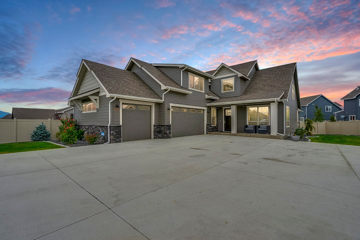 WELCOME TO YOUR NEW HOME! Built in 2017, this Parade of Homes award winning floor plan is in like-new condition and move-in ready. With plenty of space for the whole family, this elegantly designed 4 bed/2.5 bath 3,265 sq/ft home features a private shared driveway entrance, 3 car garage with plenty of exterior parking, bonus room, master bedroom suite, 60'' stone linear gas fireplace with extra-large mantle, fully wrapped windows, 8' doors, mudroom with sink, covered back deck, fully fenced back yard and much, MUCH more! From the moment you walk in you will fall in love with the open floor plan and abundance of natural light. The kitchen/living setup is an entertainer's dream with an oversized kitchen island, dark quartz countertops, stainless steel appliances, stainless steel back splash,