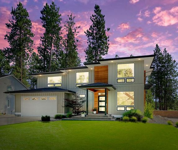 Introducing a Spokane River PREMIER view property located 10 minutes to Couer d'Alene. You will never tire of the amazing river views in this light and bright modern prairie style custom home designed by a local architect and owner/interior designer. The home has been designed to emphasize the expansive, unobstructed Spokane River view. The river view is protected by a 50-foot set-back requirement of the adjacent lot to the south and the Ross Point Recreation water front park to the east. The 3,159 sq. ft., 3 bed/2.5 bath home has everything you can dream of: 9' ceilings on both floors, gourmet kitchen with custom cabinets, huge Cambria quartz island, composite sink, large pantry, stainless steel appliances