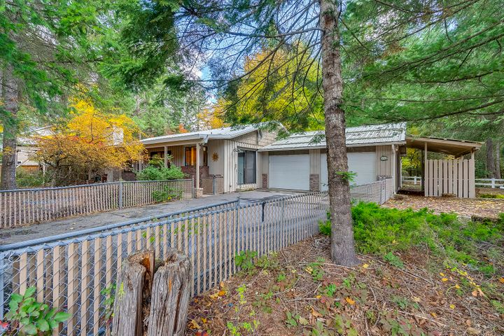 Once in a lifetime opportunity. This diamond in the rough is positioned between Hayden Lake Country Club and Honeysuckle Public Beach & Boat Launch. Consisting of 3 lots totaling 0.42 acres. This 2 bedroom, 2 bath 1956 Rancher is 1548 SF & has covered 13 x 26 RV Parking. This home is pre-inspected & ready for your remodeling Contractor, Builder or Sweat equity. Cash Only. Sold as is.