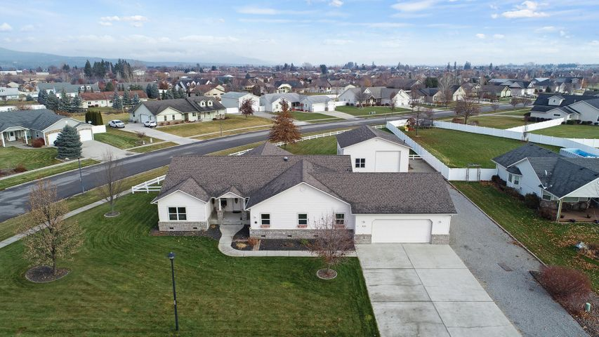 Prairie Meadows Rancher  on .75 acre with a 32x36 shop.  This is an immaculate home with an open floor concept featuring 3 bedrooms 2 bath, office and a large laundry room with an area for crafts.  Kitchen has loads of cabinets and storage galore throughout the entire home.