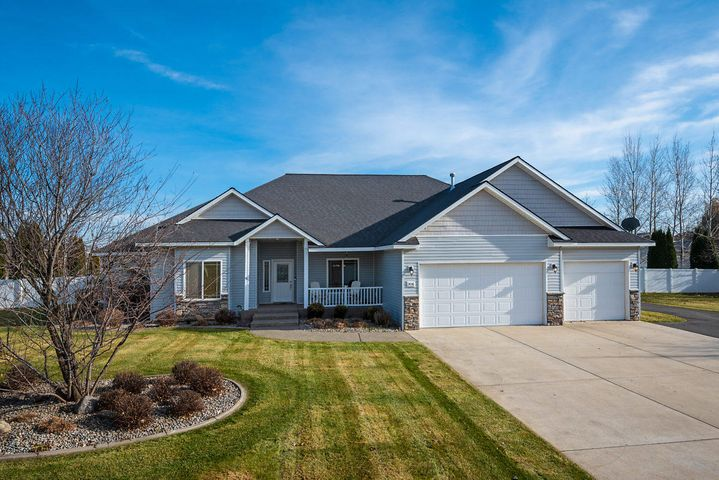 Immaculate, one-owner rancher in desirable Prairie Meadows! Home features an open and convenient floor plan with 3 bedrooms, 2.5 baths, plus an office and 3 car garage. Granite countertops, stainless steel appliances, gas fireplace, A/C, beautiful laminate and tile flooring throughout the house. Paved driveway to insulated and heated 30x50 shop with 220V power. Lots of room for entertainment on the large Trex back deck. Very spacious 1 acre lot with the sprinkler system and low maintenance landscaping. Schedule your showing before it's gone!